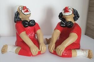 14117 & 9085.80   Clown, sitzend, gegrätschte Haltung, verträumt   1987