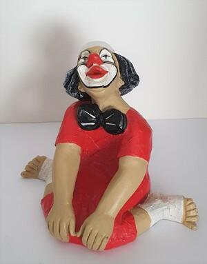 14117.A   Clown, sitzend, gegrätschte Haltung, verträumt   1987