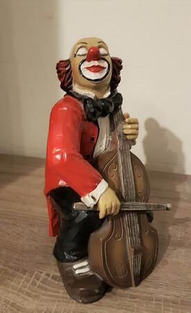 9056.80   Clown sitzend, Cello