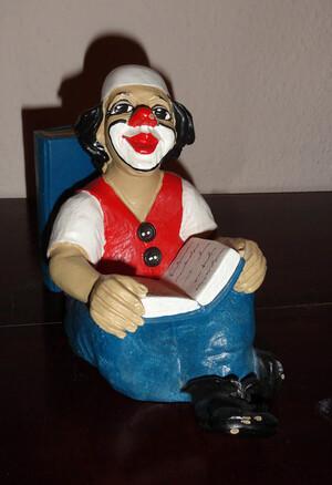 14114   Buchstütze   Clown   lesend   1988